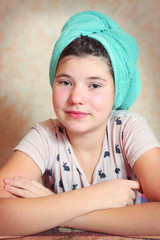 beautiful preteen girl with wet hair in towel after shower