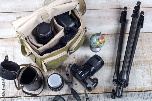 Leinwanddruck Bild photographer camera bag and tripod