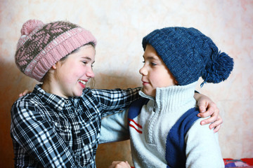 handsome preteen siblings boy and girl in winter knitted hat