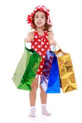 Happy joyful little girl with shopping bags.