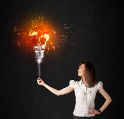 Businesswoman with an explosion bulb