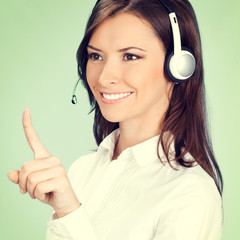 Support phone operator pointing, over green