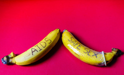 AIDS and Safe sex concept of condom on banana for gay