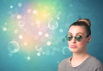 Young woman with sunglasses and bokeh colourful lights