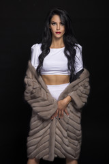 brunette in a fur coat