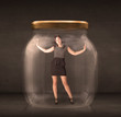 Businesswoman captured in a glass jar concept