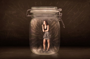 Businesswoman inside a jar with powerful hand drawn lines concep