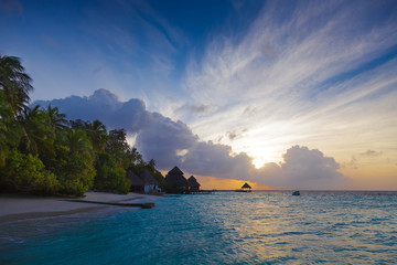 Dawn in the Maldives with lagoon views, and bungalows