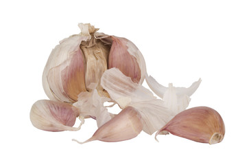 Pealed garlic with three cloves isolated on white
