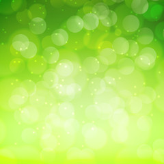 Spring green bokeh abstract light background.