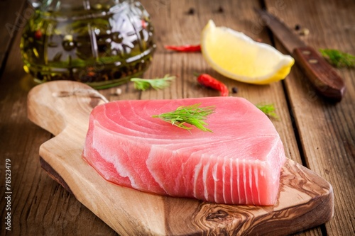 Fototapeta Raw tuna fillet with dill, lemon and olive oil