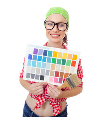 Smiling woman holding paintbrush and color samples
