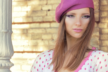 girl in a pink hat makeup in white jacket in pink polka dot