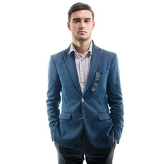 Young handsome guy standing alone with his hands pockets
