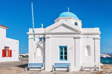 Whitewashed and blue domed Agios Nikolaos church in Mykonos