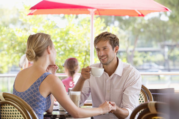 Couple talking at outdoor cafe