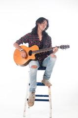 Long hair guy playing guitar acoustic