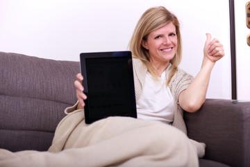 woman showing blank digital tablet
