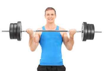 Male bodybuilding lifting a barbell