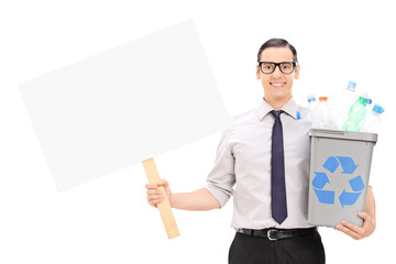 Man holding a recycle bin and a blank banner