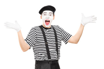 Mime artist gesturing joy with his hands