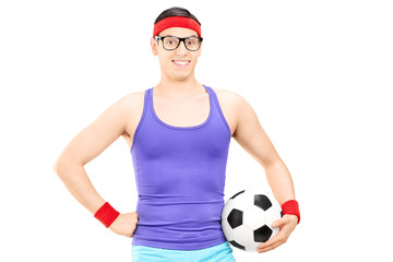 Nerdy athlete holding a football