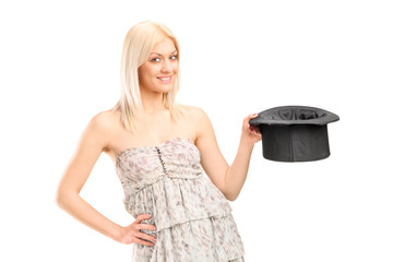 Woman holding a magician hat