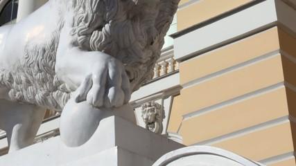 lion with a ball sculpture