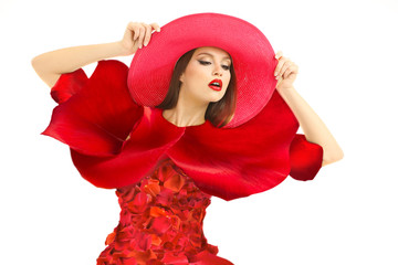 Beautiful young woman in dress made of red rose petals isolated