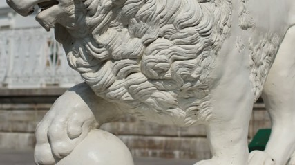 mighty lion with ball sculpture
