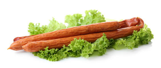 Smoked thin sausages  with lettuce salad leaves, isolated