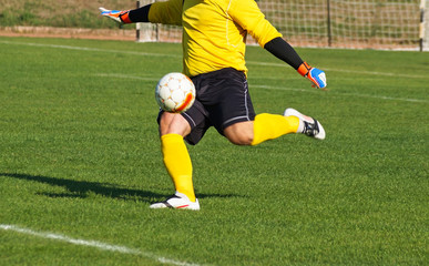 Goolkeeper is kicking off the ball