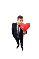 Businessman with heart shaped balloon.