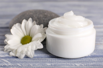 Cosmetic cream with spa stones and chamomile