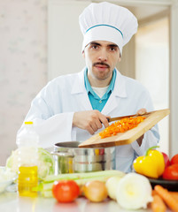 chef works with vegetables