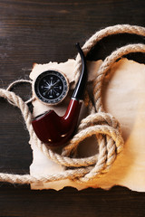 Marine still life pipe, compass, rope and sheet of paper