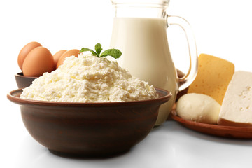 Dairy products in pottery,eggs and glass jug of milk isolated