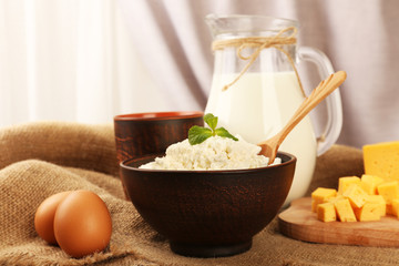 Tasty dairy products on table on fabric background