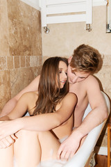 Beautiful young couple enjoying a bath.