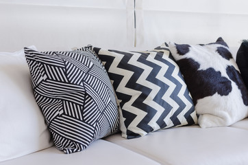black and white pillows on white sofa in living room