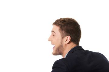 Angry businessman screaming.