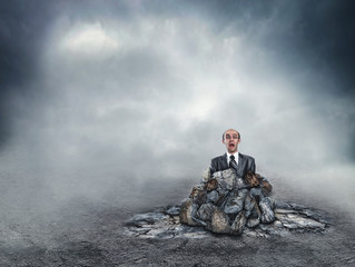 Scared businessman in the soil