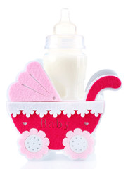 Pink little pram and bottle of milk isolated on white