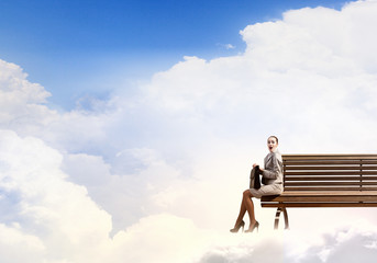Businesswoman on bench