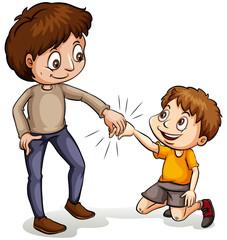 A man helping a young boy