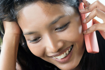 Young woman calling by phone