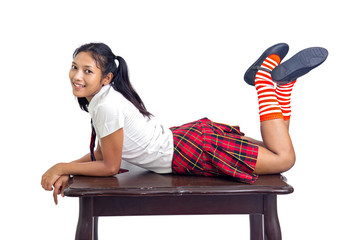 student lying at a desk