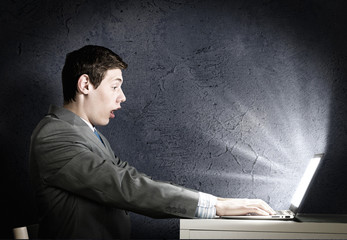 Emotional man using laptop