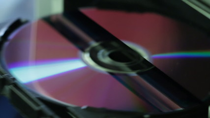 Close up view of CD - DVD in and out of the computer