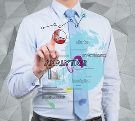 businessman touching analytics
